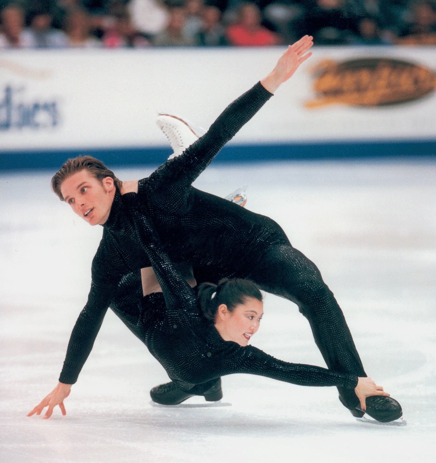 Kyoko Ina and John Zimmerman  won bronze at Worlds in 2002. Before teaming with Zimmerman, Ina skated with Jason Dungjen, winning US Nationals in 1997 and 1998.